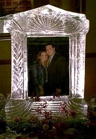 Click on image to view full size [IMAGE - Bride and Groom framed in ice]